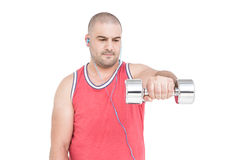 Athlete working out with dumbbells. On white background Royalty Free Stock Photography