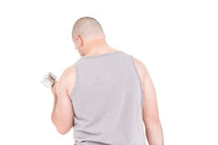 Athlete working out with dumbbells. On white background Royalty Free Stock Photo