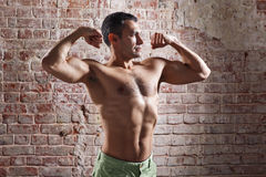 Athlete after a workout on old red bricks background Royalty Free Stock Photo