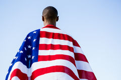 Athlete wrapped in american flag stock photography