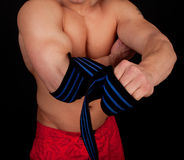 Athlete wrapping his hands Stock Photos