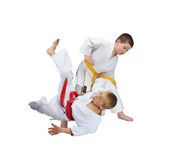 An athlete with a yellow belt throws athlete  with a red belt Royalty Free Stock Photography