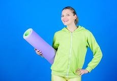 Athlete yoga coach. Yoga class concept. Yoga as hobby and sport. Practicing yoga every day. Girl slim fit athlete hold. Fitness mat. Fitness and stretching stock photos