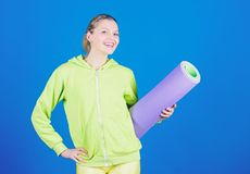 Athlete yoga coach. Yoga class concept. Yoga as hobby and sport. Practicing yoga every day. Girl slim fit athlete hold. Fitness mat. Fitness and stretching royalty free stock images