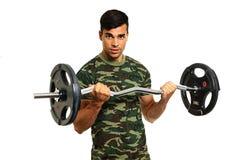 Athlete young  man exercises Royalty Free Stock Photo