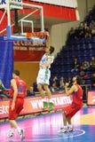 Athlete from Zalgiris team throws ball into basketball hoop Stock Photos