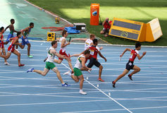 Athletes on the 4 x 100 meters relay race. BARCELONA, SPAIN - JULY 13: Athletes on the 4 x 100 meters relay race on the IAAF World Junior Championships on July royalty free stock images