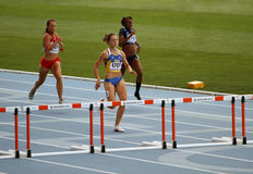 Athletes in the 400 meters hurdles Royalty Free Stock Images