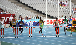 Athletes in the 400 meters hurdles final Stock Photo