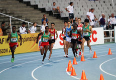 Athletes in the 5000 meters on the 2012 IAAF World Stock Photos
