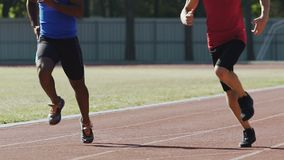 Athletes actively training at outdoor sports ground, preparing for competition. Stock footage stock footage