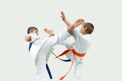 Athletes beating blows mavashi geri on meet each other Stock Image
