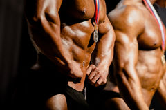 Athletes bodybuilders with medals. Winners at bodybuilding competitions royalty free stock photography