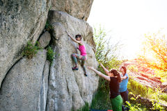 Athletes are bouldering outdoors. Stock Image