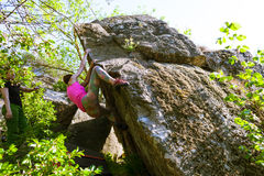 Athletes are bouldering outdoors. Royalty Free Stock Images