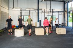 Athletes In Box Jumping Class Royalty Free Stock Photos