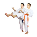 Athletes boys train beat kicks on the white background Stock Photos