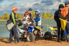 Athletes and coaches. SERPUKHOV, RUSSIA - OCTOBER 7, 2017:  Before the race, Class ATV, in the 4 stage  MX series, the Red Wings Cup 2017 super country-cross Royalty Free Stock Images