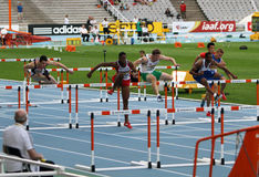 Athletes compete in the 110 meters final Stock Photos