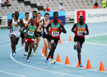 Athletes compete in the 3000 metres steeplechase Stock Image