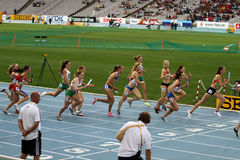 Athletes compete in the 4x400 relay race Stock Images