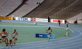 Athletes compete in the 4x400 relay race Royalty Free Stock Image