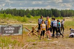 Athletes creep under barbed wire. Tyumen. Russia Royalty Free Stock Image
