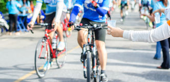 Athletes, cyclists get drinking water. Royalty Free Stock Images