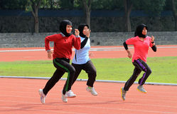 Athletes. Do exercises in a stadium in the city of Solo, Central Java, Indonesia Stock Photo