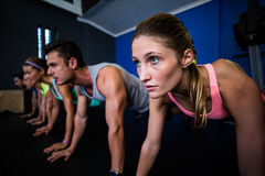 Athletes doing push-ups in gym Royalty Free Stock Image