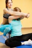 Athletes engaged yoga in sportswear. Athletes engaged yoga in sports clothes at gym Royalty Free Stock Images