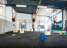 Athletes Exercising On Gymnastic Rings Stock Photo