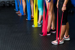 Athletes exercising with resistance band Royalty Free Stock Photo