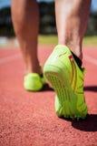 Athletes feet running on the racing track Stock Photo