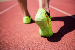 Athletes feet running on the racing track Stock Images