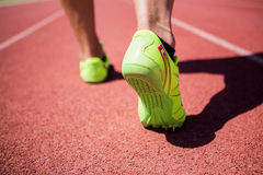 Athletes feet running on the racing track Royalty Free Stock Photos