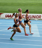 Athletes on the finish of 400 meters race Royalty Free Stock Images
