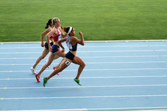 Athletes on the finish of 400 meters race Royalty Free Stock Image