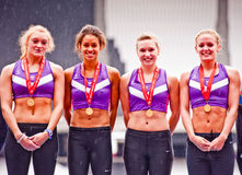 Athletes with gold medal at London Olympic stadium Stock Photo