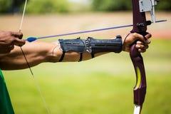 Athletes hand practicing archery stock photos