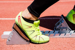 Athletes hands on a starting block. Close-up of athletes hands on a starting block  about to run Stock Image