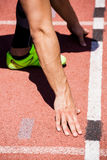 Athletes hands on a starting block. About to run Royalty Free Stock Photo