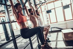Athletes Hang On Horizontal Bar With Drowned Legs. Athletes Hang On Horizontal Bar With A Drowned Legs. Training Day. Fitness Club. Healthy Lifestyle. Powerful royalty free stock photography