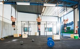 Athletes Hanging On Gymnastic Rings Stock Photography