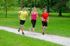 Athletes jogging in the park Stock Photos