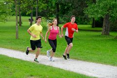 Athletes jogging in the park Royalty Free Stock Photography