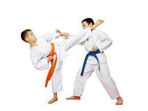 Athletes karate are training paired exercises on a white background Stock Photography