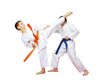 Athletes karate are training paired exercises on a white background Stock Images