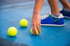 Athletes keep the tennis ball on a tennis court Stock Photos