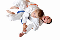Athletes in a kimono with a blue and orange belt make the receipt of  capture hand Stock Photo